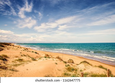 fishing in solitude Guardamar del Segura Beach with sand dunes.Alicante, Spain
