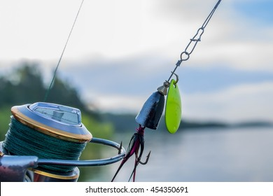 fishing spinning lure on fishing reel at the lake