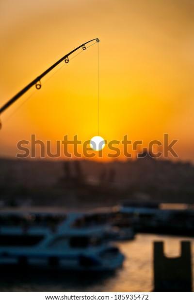Fishing the sun, strait of Bosphorus, Istanbul, Turkey