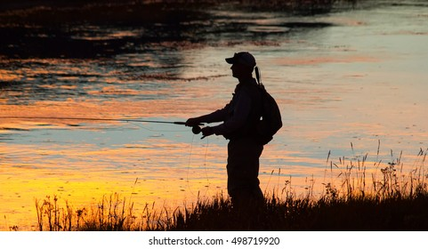 Fishing at sunset in the Yellowstone national park