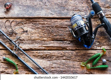 fishing tackle and bait on wooden background