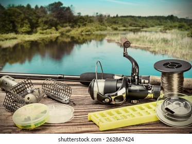 fishing tackle on a pontoon on the background of the lake in the woods. toning image
