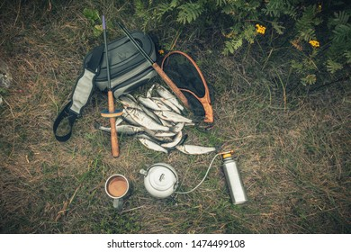 Fishing tackle on the river. Snack on a fishing trip.
