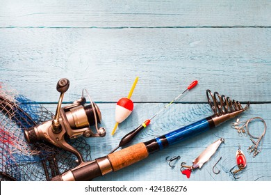 Fishing tackle on wooden blue background