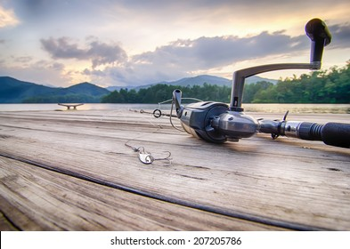 fishing tackle on a wooden float with mountain background and selective focus