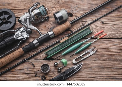 Fishing tackle for fishing peaceful fish. Float, fishing rod, reel, fishing line on the wooden background
