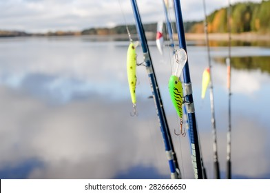 Fishing tackle for fishing rod on lake background