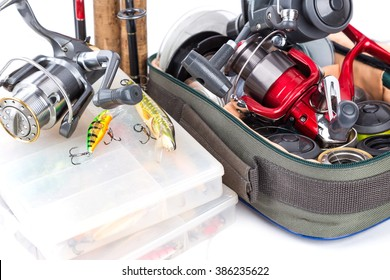 fishing tackles and baits in box and bag on white background for outdoor active business