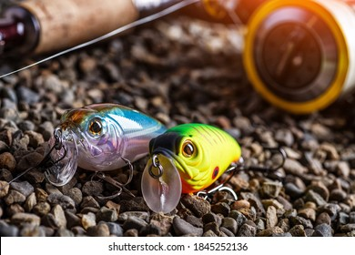 Fishing theme.Fishing tackle - fishing spinning, lures and wobblers.Closeup of a fishing box with colorful lures.
