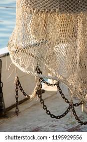 Fishing trawl net hanging on a trawler boat deck