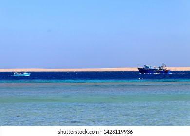 Fishing trawler and old fishing boat sails at Red sea in Hurghada, Egypt