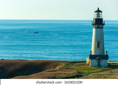A Fishing Trawler Passes By the Yaquina Head Lighthouse, Newport, Oregon