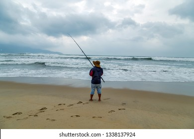 Fishing trolling tuna in deep blue sea with rods and reels from beach. sunset fishing activity