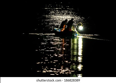 Fishing under the moon light, in Syros island, Greece