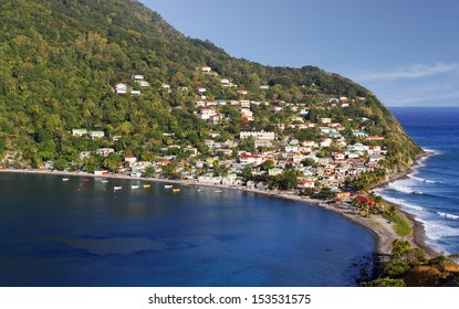 Fishing village in Dominica, Caribbean Islands Scotts Head Dominica is a fishing village in Domica, Caribbean Island. It is the meeting point of Atlantic Ocean and the Caribbean Sea (Soufriere Bay).
