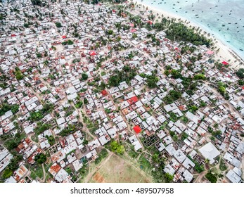 fishing village on african island with rows of poor houses, top view, aerial photo