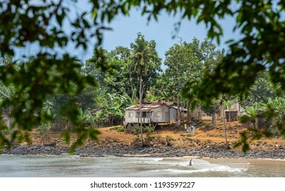 Fishing Village on the beach, self built wooden villager house homes. Travel to Sao Tome and Principe. Beautiful paradise island in Gulf of Guinea. Former colony of Portugal.