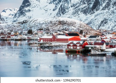 Fishing village of Reine on frosty coastline with snowy mountain at Lofoten islands