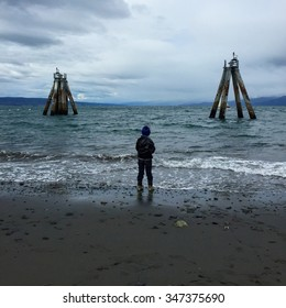 Fishing is a way of life in southern Alaska along the coast, and it starts at a young age/Alaskan boy fishing at the pier/In Homer, Alaska fishing is the way of life, and it starts as a young child