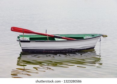 fishing wooden boat moored in the sea
