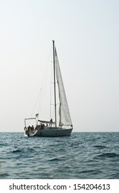 Fishing yacht in the Black sea on blue sky background