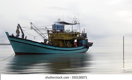 fishman boat on moring at the sea