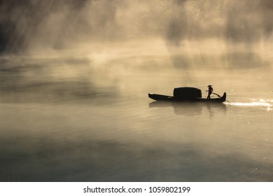 Fishman in the morning mist in China