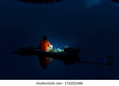 fishman on small boat catch shrimp
