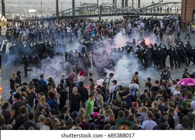 "Fishmarket/Hamburg - Germany July 6, 2017: Policemen are storming the protest ""Welcome to Hell"" on thursday prior to the G20 Summit."
