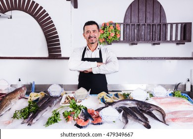 fishmonger  smiling and fresh fish weighs