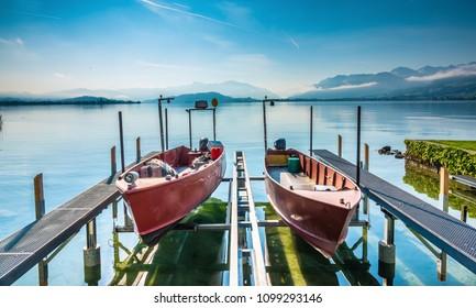Fisihing boats on the piers of the ancient village of Hurden, Upper Lake Zurich (Obersee), Schwyz, Switzerland