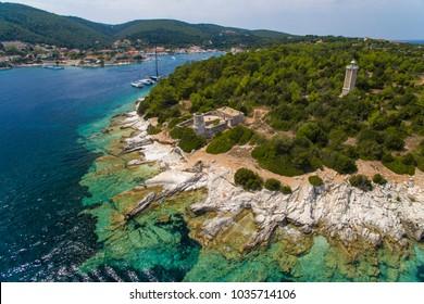 Fiskardo lighthouse, village, bay and port in Kefalonia island, Greece