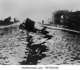 Fissure and sink in East Street near Ferry Building after the San Francisco Earthquake, 1906. A carriage fell into cracks in roadway near the waterfront caused by lateral spreading in the area