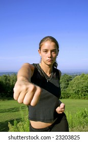 Young girl self fist