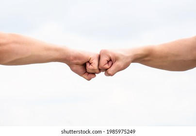 Fist Bump. Clash of two fists. Concept of confrontation, competition. Gesture of giving respect or approval. Teamwork and friendship. Partnership concept. Man giving fist bump. Bumping fists together