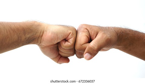 Fist bump confrontation of two strong  hairy hand.