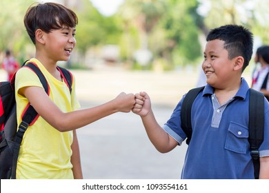Fist Bump Friends Deal Partner Touch Pair Hands. Elementary students greet each other Trust in Team Giving Fist Bump to Greeting Start up Back to School or Say goodbye on weekends. education concept