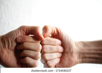 Fist bump on white background.