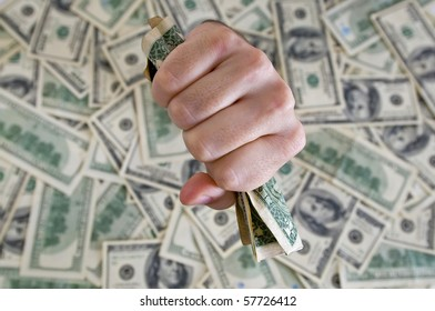 a fist with dollars breaking through a dollar background