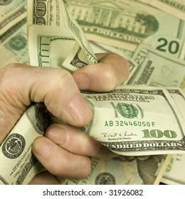 Fist full of cash. Focus on the cash.