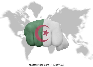 fist with the national flag of algeria on a world map background