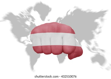 fist with the national flag of austria on a world map background