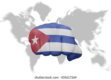 fist with the national flag of cuba on a world map background