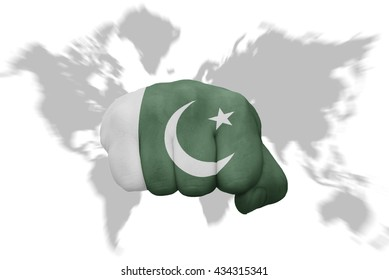 fist with the national flag of pakistan on a world map background