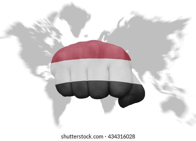 fist with the national flag of yemen on a world map background