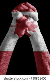 Fist painted in colors of Canada flag, fist flag, country of Canada