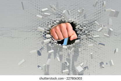 Fist punching through brick wall. Business concept
