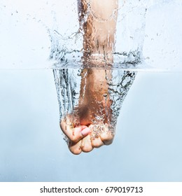 Fist punching water splash