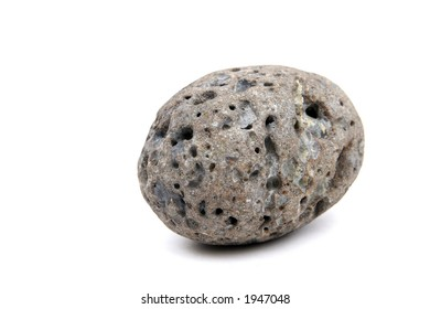 A fist sized meteor looking rock found in a mountain stream.