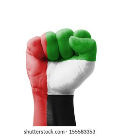 Fist of UAE (United Arab Emirates) flag painted, multi purpose concept - isolated on white background